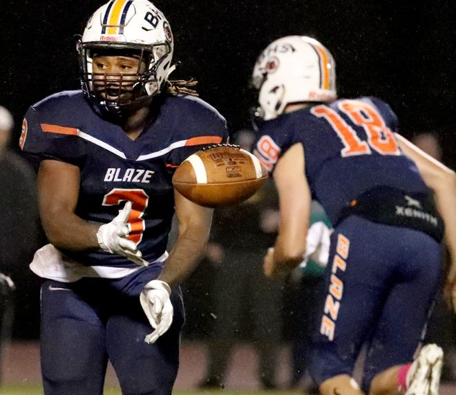Blackman's Tamicus Napier (3) tosses the ball back to teammate Michaleous Elder (7) on a reverse during Friday's 41-0 win over Riverdale.