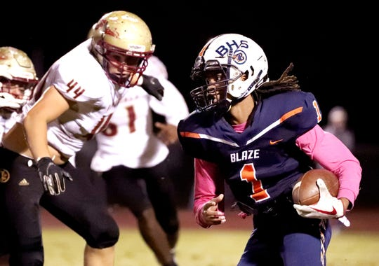 Blackman's Adonis Otey (1) runs the ball as Riverdale's George Psychoularis  (44) moves in for a tackle at Blackman High School on Friday, Oct. 26, 2018.