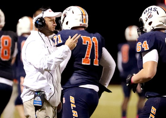 Blackman's head football coach Kit Hartsfield on the sidelines during the game against Riverdale at Blackman High School on Friday, Oct. 26, 2018.