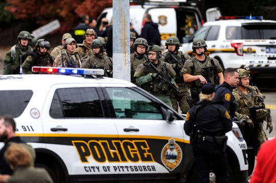 Law enforcement officers secure the scene where multiple people were shot, Saturday, Oct. 27, 2018, at the Tree of Life Congregation in Pittsburgh's Squirrel Hill neighborhood.