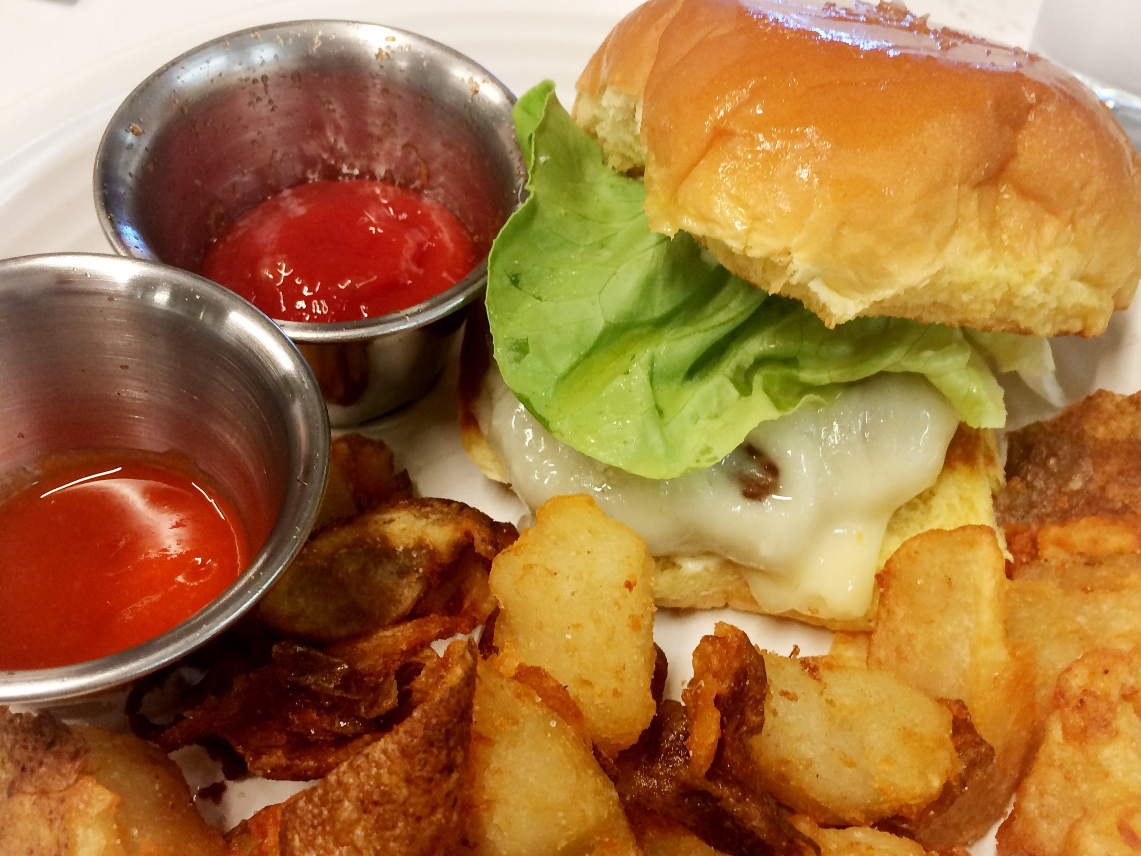 House burger (beef from Porter Road Butcher), crispy potatoes, house hot sauce and ketchup at Stay Golden restaurant and roastery.