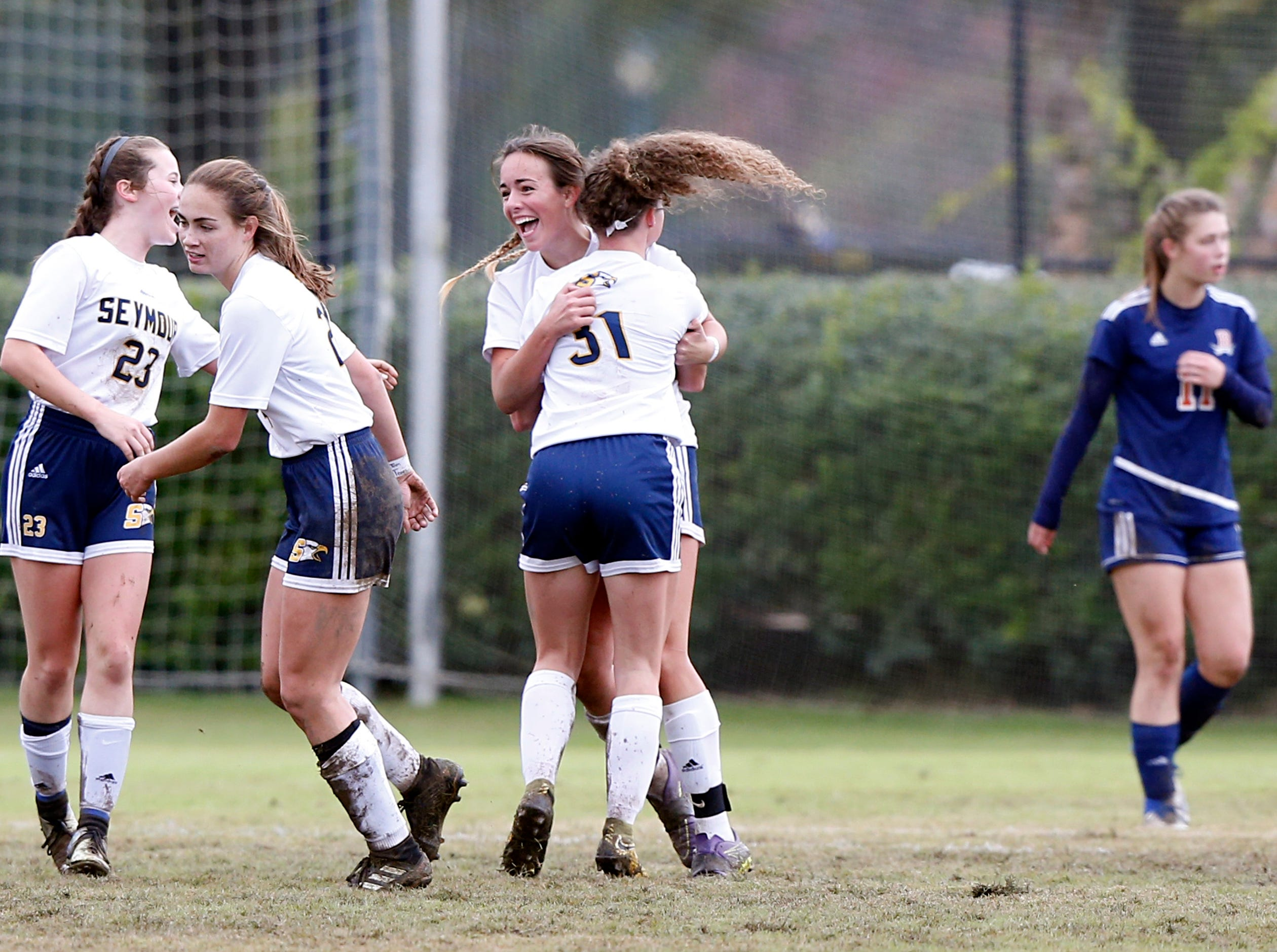 Seymour's Tyler Taff (facing) is congratulated by Anna Pendleton (31) after scoring a goal  against Beech during their Class AA soccer championship match Saturday, Oct. 27, 2018, in Murfreesboro, Tenn.