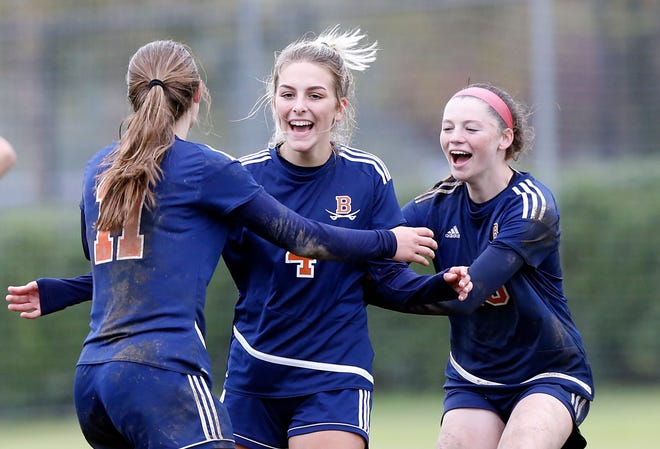 Beech's Jill Fuqua (4) celebrates scoring the game-winning goal with Hailey Burroughs (11) and Jana Stafford (10) during their Class AA soccer championship match against Seymour Saturday, Oct. 27, 2018, in Murfreesboro, Tenn. Beech won 3-2 in double overtime.