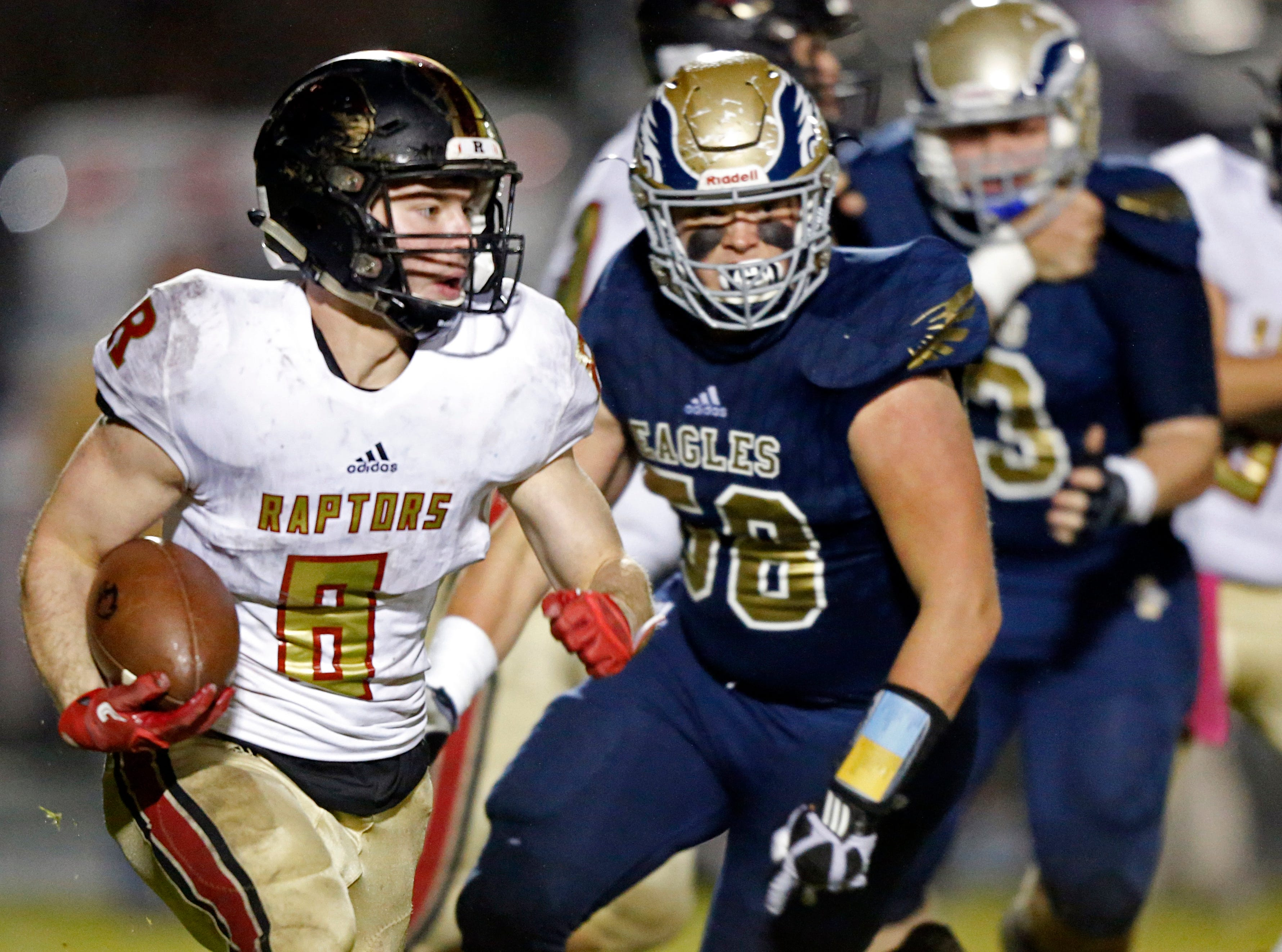 Ravenwood's William Baine runs for yardage as he's chased by Caleb Lanford of Independence during their game Friday, Oct. 26, 2018, in Thompsons Station, Tenn.