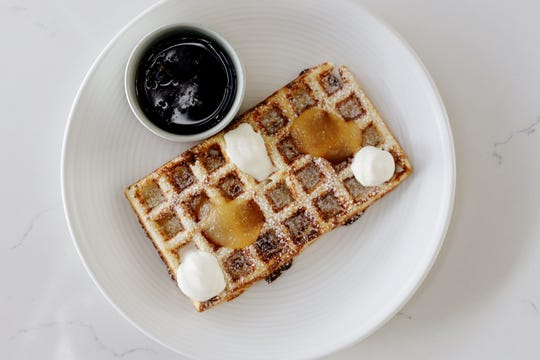 Crispy yeasted waffle with whipped creme fraiche, maple syrup and pear butter at Stay Golden restaurant and roastery.