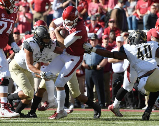 Arkansas quarterback Ty Storey is taken down by Vanderbilt defenders Dimitri Moore (7) and Jordan Griffin (40) in the first half of an NCAA college football game Saturday, Oct. 27, 2018, in Fayetteville, Ark.