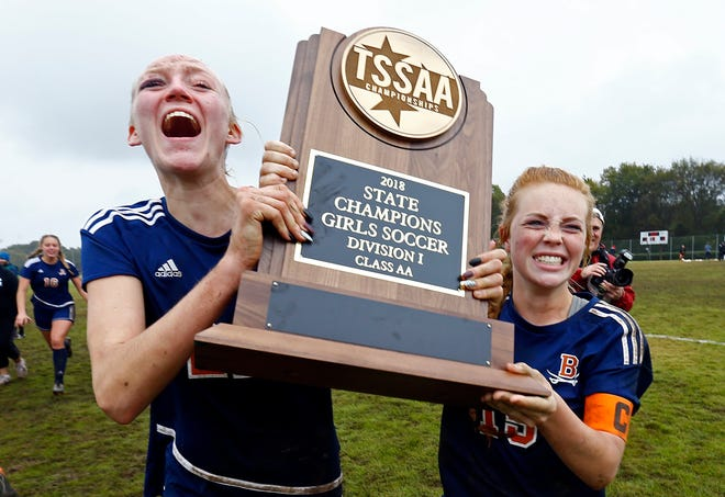 Kendra Mueller, left, and Emily Hickman of Beech celebrate with the championship trophy after their Class AA soccer championship match against Seymour Saturday, Oct. 27, 2018, in Murfreesboro, Tenn. Beech won 3-2 in double overtime.