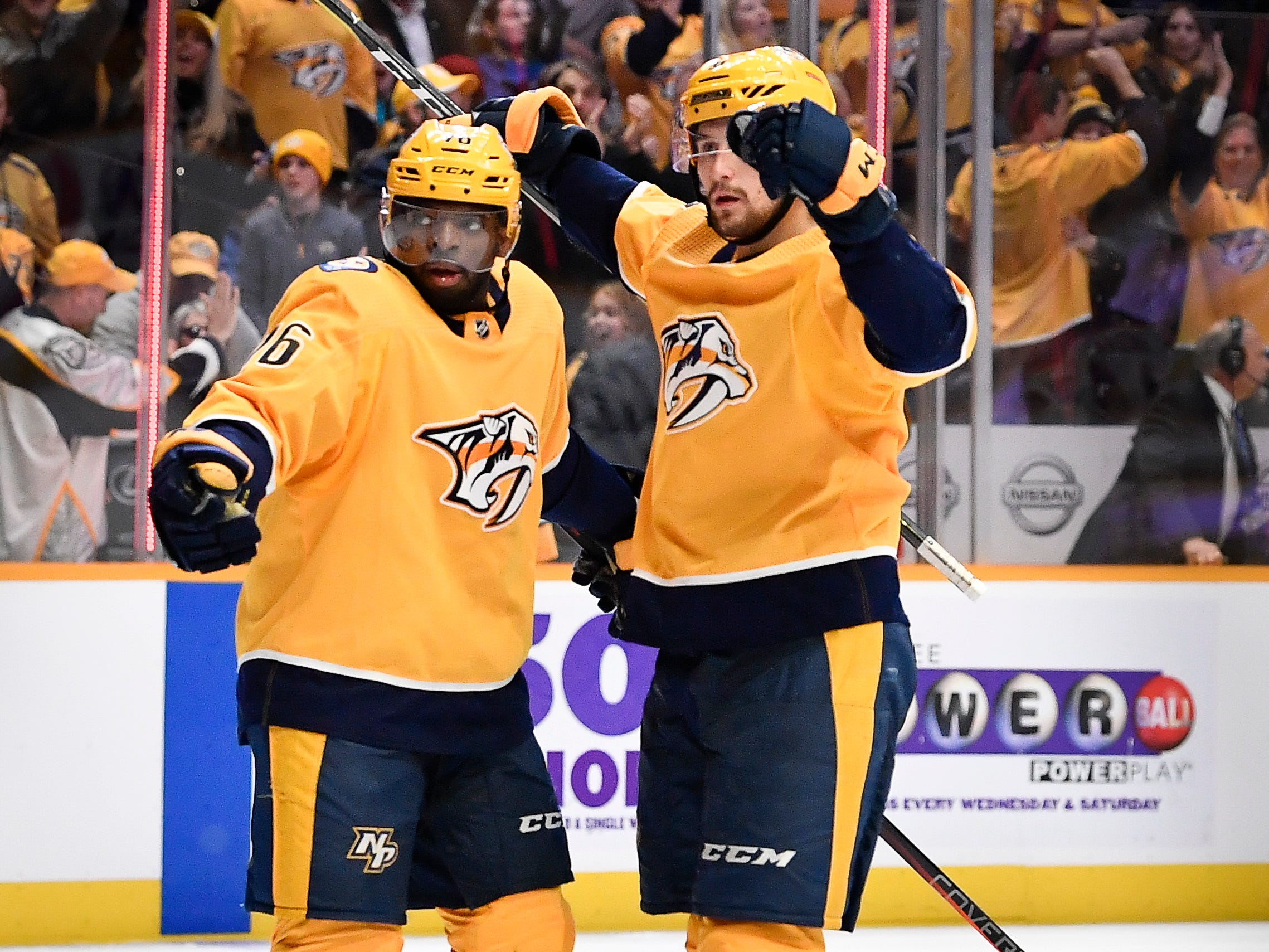 "Predators defenseman P.K. Subban (76) congratulates left wing Filip Forsberg (9) after his third goal for a ""hat trick"" against the Oilers during the third period at Bridgestone Arena Saturday, Oct. 27, 2018, in Nashville, Tenn."