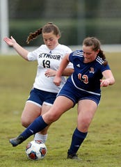 Beech's Abbey Harris (19) battles for the ball with Seymour's Emily Glaspie (19) during their Class AA soccer championship match Saturday, Oct. 27, 2018, in Murfreesboro, Tenn.