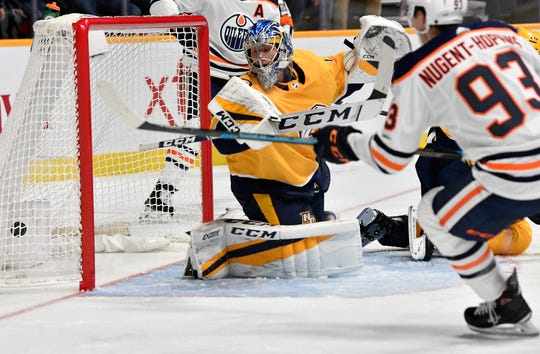Predators goaltender Juuse Saros (74) lets an Oilers power play goal slip past during the second period at Bridgestone Arena Saturday, Oct. 27, 2018, in Nashville, Tenn.