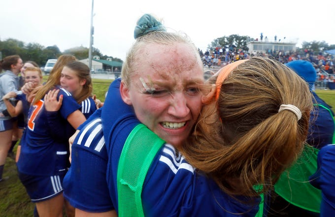 Beech's Kendra Mueller gets a hug from a teammates after their Class AA soccer championship match against Seymour Saturday, Oct. 27, 2018, in Murfreesboro, Tenn. Beech won 3-2 in double overtime.