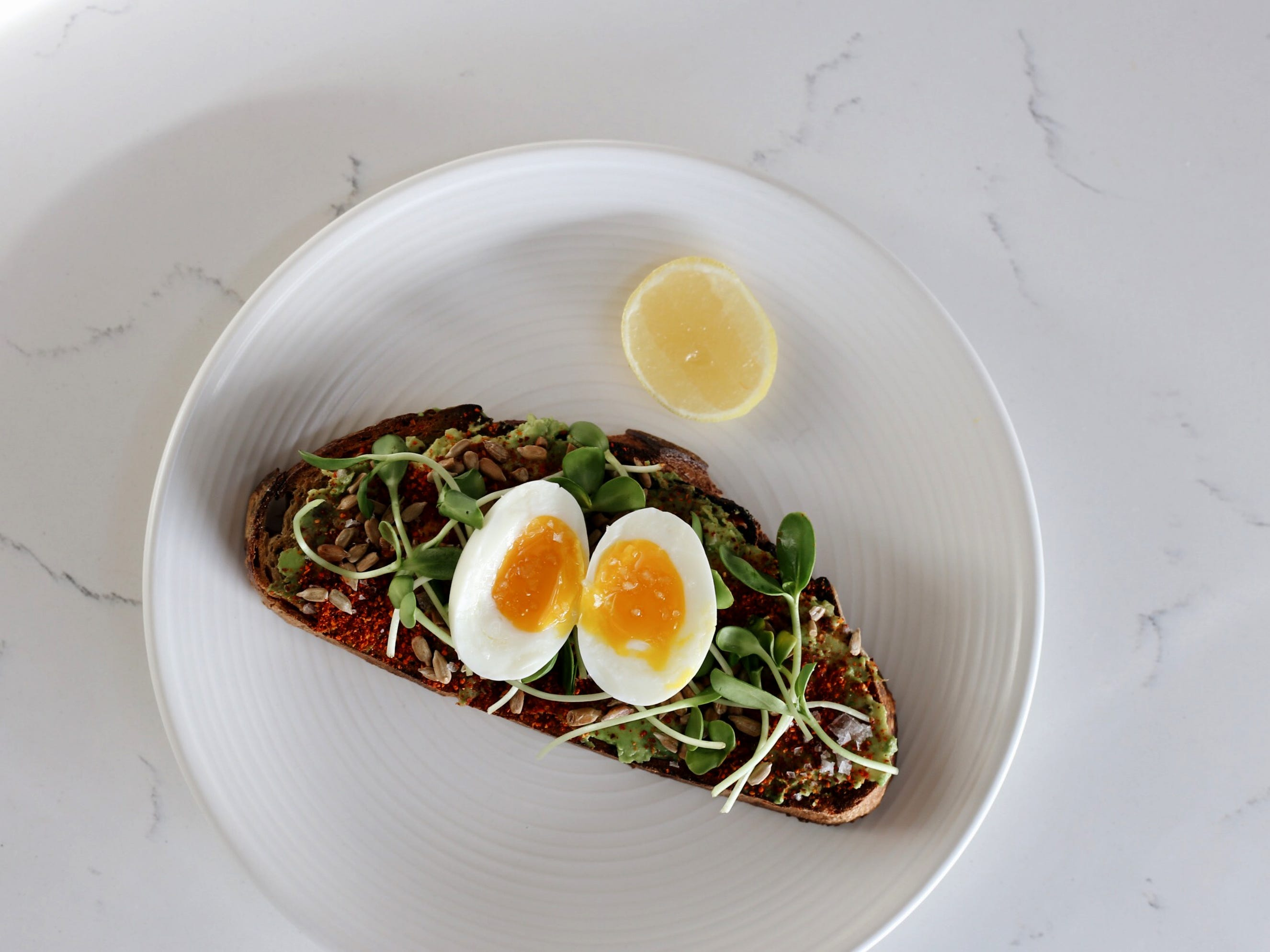 Avocado toast with soft boiled egg at Stay Golden restaurant and roastery.
