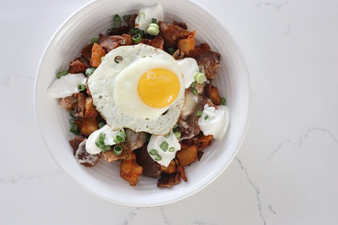 Brunch Bowl: Loaded crispy potatoes with bacon, scallions, cheddar, sour cream and egg at the Stay Golden restaurant and roastery.