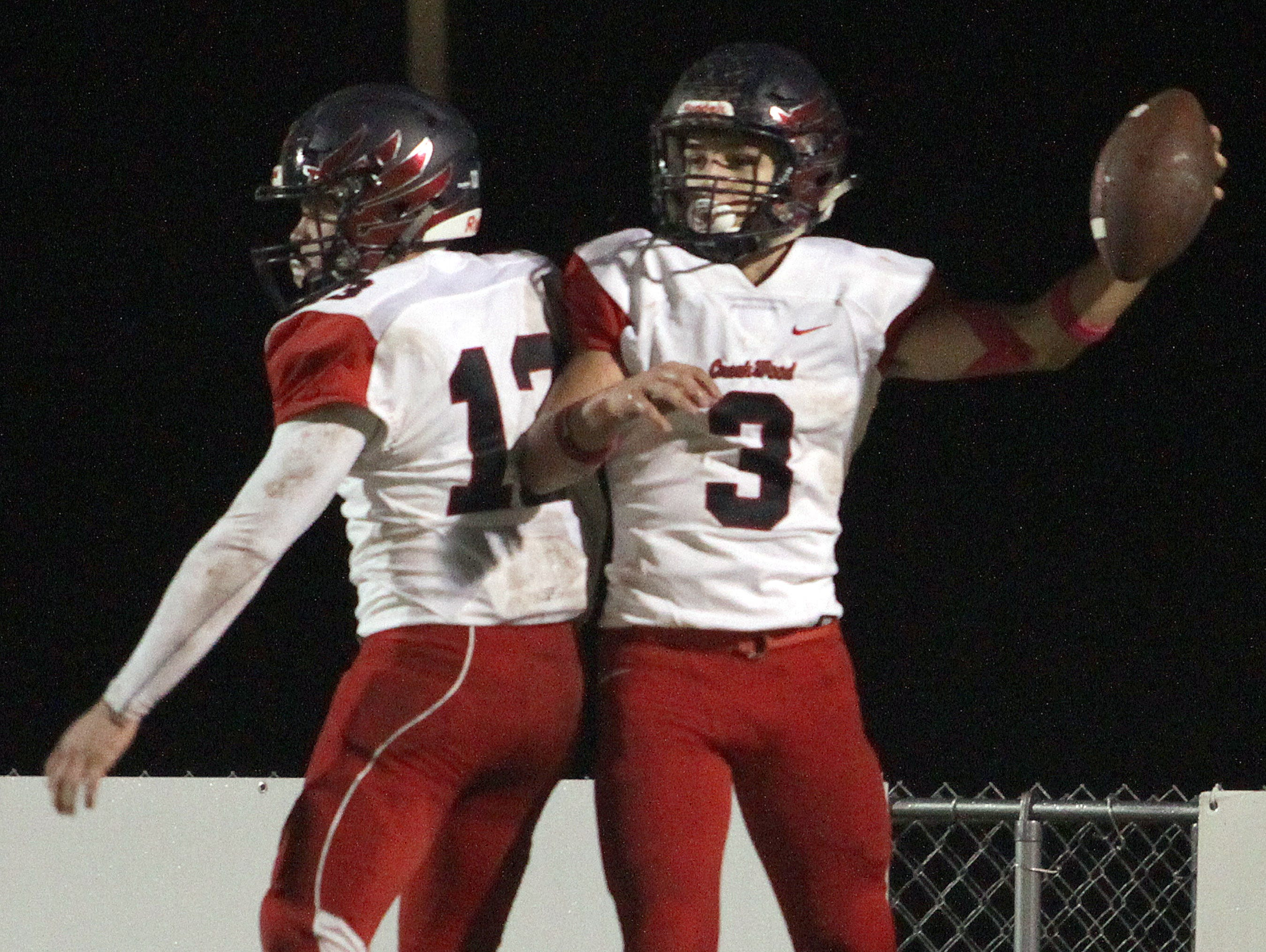 Creek Wood's Brock Veach and Wil Secker celebrate a score against Springfield on Friday, October 26, 2018.
