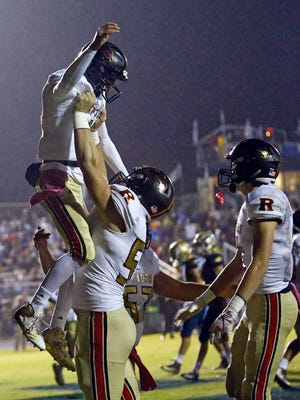 Ravenwood's Brian Garcia celebrates with teammates after scoreing a touchdown during their game against Independence Friday, Oct. 26, 2018, in Thompson's Station, Tenn.