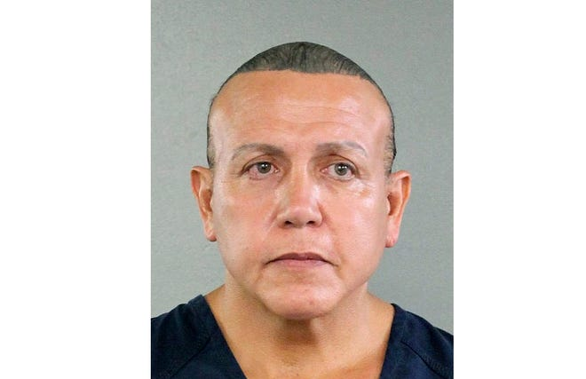 In this undated photo released by the Broward County Sheriff's office, Cesar Sayoc is seen in a booking photo, in Miami.