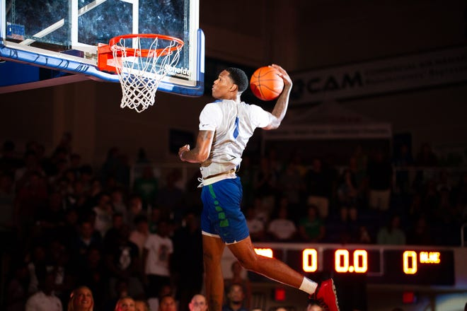 FGCU's Troy Baxter goes up to dunk during Dunk City After Dark at Alico Arena in October. Baxter, who won the dunk contest, declared for the NBA Draft but did not sign with an agent Friday.