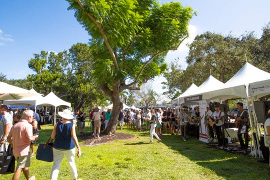 The second annual Paradise Coast Wine & Food Experience at Cambier Park in Naples, FL. Saturday, Oct. 27, 2018. Nearly 2,000 people turned out for the event. Dozens of Southwest Florida restaurants and businesses participated in the event as festivalgoers enjoyed the breezy weather.