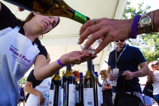 Megan Justus of Napa Valley booth pours wines for participants of the second annual Paradise Coast Wine & Food Experience at Cambier Park in Naples, FL. Saturday, Oct. 27, 2018.