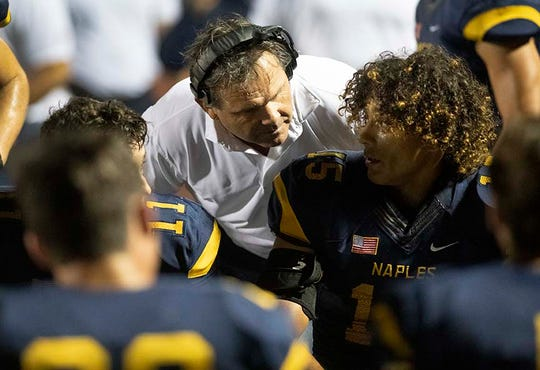 Naples head coach Bill Kramer talks with Dominic Mammarelli during the game against Barron Collier at Naples High last season.