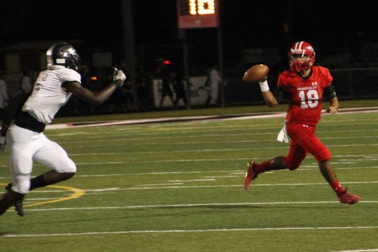 Immokalee quarterback R.J. Rosales looks to pass during the Indians' 49-33 victory over Mariner at Gary Bates Stadium on Friday.