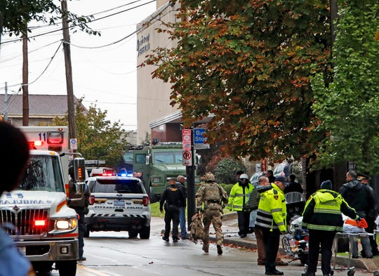 """First responders surround the Tree of Life Synagogue in Pittsburgh, rear center, where a shooter opened fire Saturday, Oct. 27, 2018, wounding three police officers and causing """"multiple casualties,"""" according to police."""