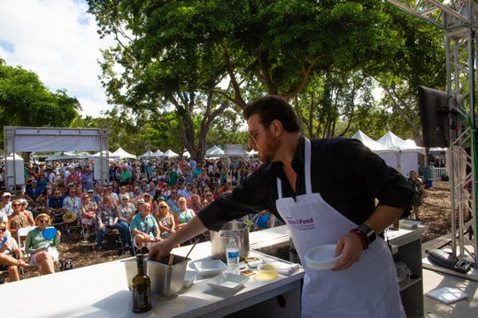 Celebrity chef, Scott Conant, gives a cooking demonstration on the culinary stage during the second annual Paradise Coast Wine & Food Experience at Cambier Park in Naples, FL. Saturday, Oct. 27, 2018. Nearly 2,000 people turned out for the event. Dozens of Southwest Florida restaurants and businesses participated in the event as festivalgoers enjoyed the breezy weather.