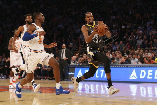 Oct 26, 2018; New York, NY, USA; Golden State Warriors forward Kevin Durant (35) drives against New York Knicks guard Damyean Dotson (21) during the first quarter at Madison Square Garden.