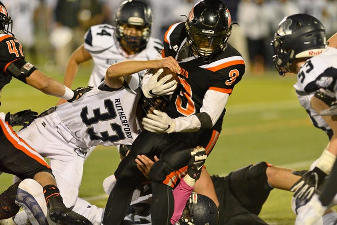 Hasbrouck Heights' Jasiah Purdie runs the ball against Rutherford.