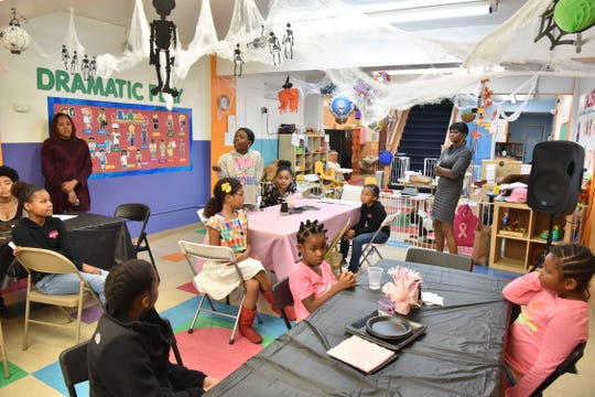 Children take part in a mentoring class with the students of William Paterson University's group the Sisters for Awareness Black Leadership and Equality (SABLE) in Passaic, NJ.