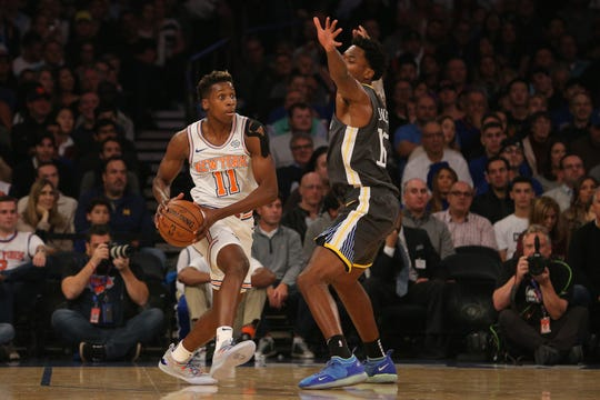 Oct 26, 2018; New York, NY, USA; New York Knicks guard Frank Ntilikina (11) looks to pass against Golden State Warriors center Damian Jones (15) during the first quarter at Madison Square Garden.