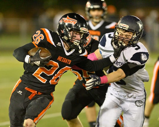 Hasbrouck Heights' Michael Robertson runs the ball against Rutherford.