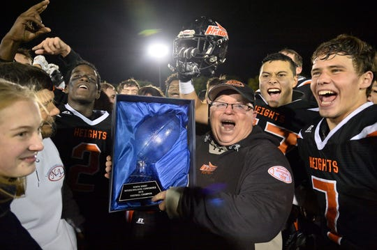 Hasbrouck Heights coach Nick Delcalzo celebrates with his team after winning the game against Rutherford.