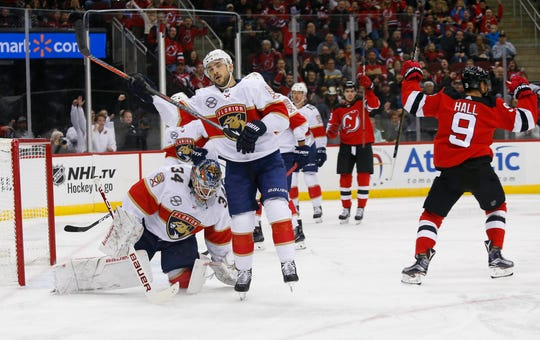 Florida Panthers goaltender James Reimer (34) and Florida Panthers center Colton Sceviour (7) react after a by New Jersey Devils left wing Taylor Hall (9) during the second period at Prudential Center.