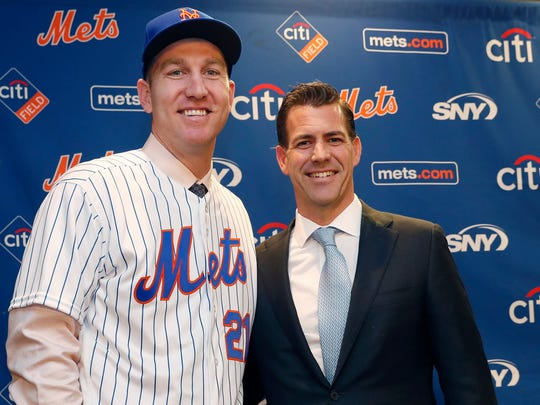 ILE - In this Wednesday, Feb. 7, 2018, file photo, New York Mets newly-signed third baseman Todd Frazier, left, poses for photographers with his agent, Brodie Van Wagenen, after the former New York Yankees third baseman signed with the Mets, in New York. Van Wagenen interviewed Monday, Oct. 22, 2018, to switch sides and become general manager of the New York Mets and is among three finalists along with former Milwaukee GM Doug Melvin and Tampa Bay senior vice president of baseball operations Chaim Bloom.