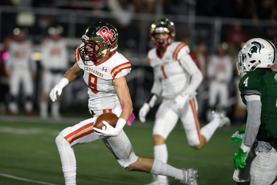 Bergen Catholic football at DePaul on Friday, October 26, 2018.  BC #8 Garrett Codey on his way to scoring a touchdown after making a catch in the first quarter.