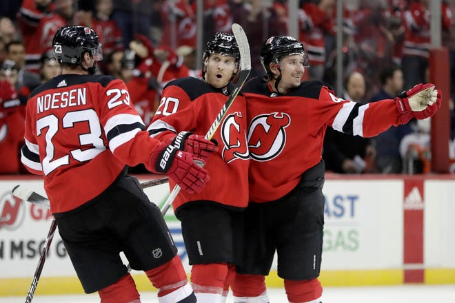 New Jersey Devils center Blake Coleman, center, celebrates his goal against the Florida Panthers with teammates Stefan Noesen (23) and Sami Vatanen (45), of Finland, during the second period of an NHL hockey game, Saturday, Oct. 27, 2018, in Newark, N.J.