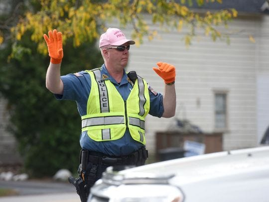 Park Ridge Police Officer Scott Laughton wears a pink cap to benefit breast cancer research.