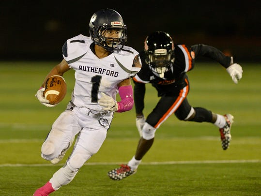 Rutherford's Abellany Mendez runs the ball against Hasbrouck Heights.