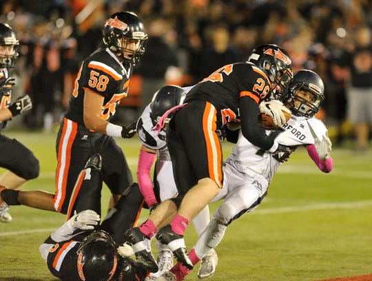 Rutherford QB Kyle Russell gets sacked by Hasbrouck Heights' Michael Robertson.