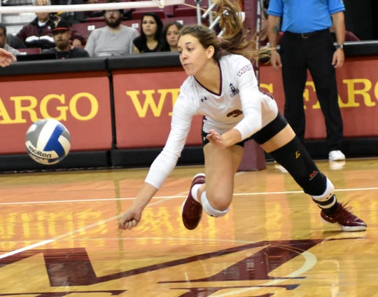 New Mexico State's Ashley Anselmo dives for a ball on Saturday afternoon against Texas Rio Grande Valley at the Pan Am Center.