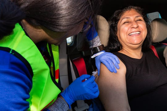 Rosalda Martinez is able to grin and bear it as she receives a flu vaccine. The Boo To The Flu drive-in flu clinic was held at Mountain View Regional Hospital on Saturday, October 27, 2018.