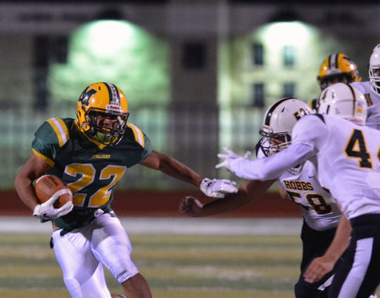 Mayfield's Mathew Riley gets ready to cut thourgh the Hobbs Eagle defense on Friday night at the Field of Dreams.