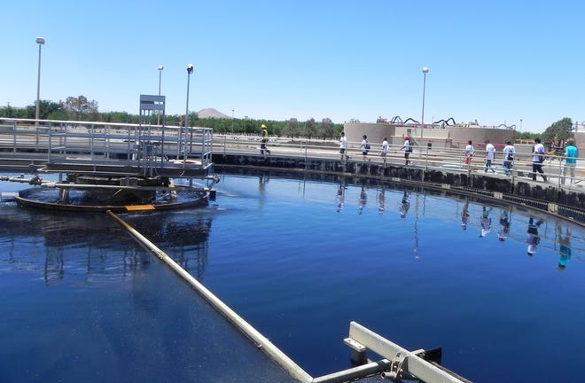 Students tour the primary clarifier at the Jacob A. Hands Wastewater Treatment Facility.