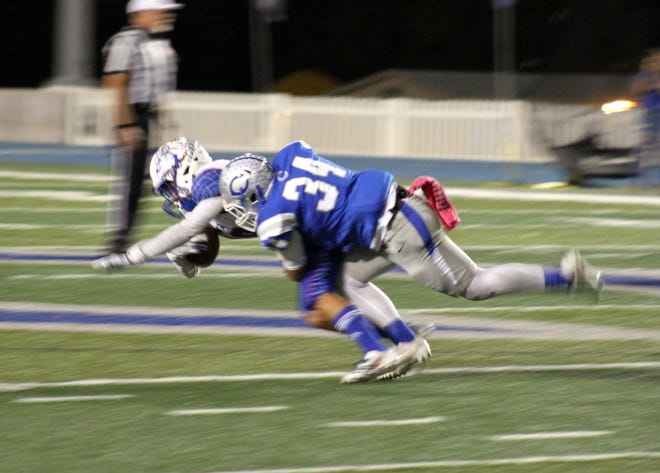 Carlsbad senior RJ Baca takes down a Las Cruces receiver during Friday's game.