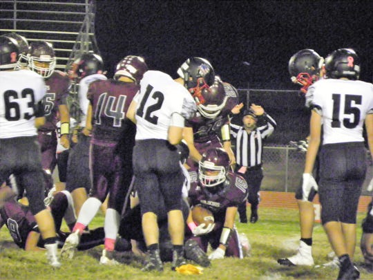 Tularosa Wildcat Marques Barraza recovers after being tackled at the  Wildcats game versus the NMMI Colts.