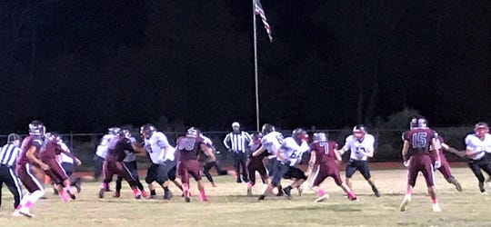 The Tularosa Wildcats in maroon beat the NMMI Colts in white uniforms Friday night 37-13.