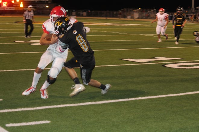 Alamogordo linebacker Will Gil puts an end to one of Roswell's drives, but the Tigers ultimately succumbed to the Coyotes 56-21.