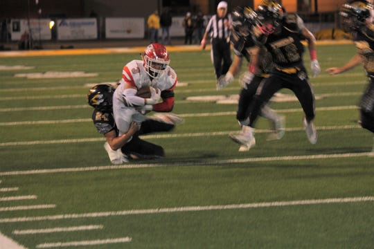 Tigers linebacker Mark Prather takes down Roswell running back Justin Carrasco in Friday's game.