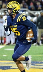 South Lyon senior receiver Ron Menard caught three touchdown passes in Friday's win over Dexter, including the game winner in overtime.